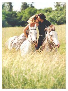 Cute engagement photo! Plus it has horses :D