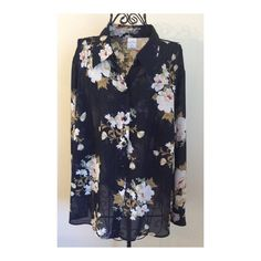 Pretty Floral Spring Top This top is 100% Polyester, and semi-sheer.  The background color is Navy. Emma James Tops Blouses