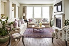 Purple patterned rug and pillows in beige living room | Duet Design Group