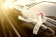 Door of black wedding car with flower and  ribbon
