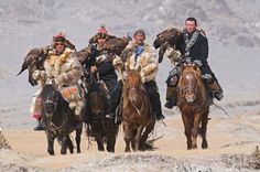 Hunters with golden eagles, Altai, Mongolia