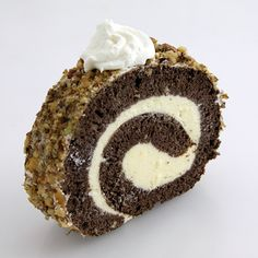 Diós Beigli | Walnut Filled Roll is a Hungarian food recipe with raisins, cinnamon and apricot jam.  Ingredients        1½ c. finely diced or chopped walnuts      1 c. sugar      ¼ c. whipping cream      ¼ c. raisins      pinch of cinnamon      2 drops of vanilla extract, or ½ tsp. vanilla sugar      2 tsp. grated lemon peel      1 tbsp. apricot jam      1 8-oz. container refrigerated dough      1 egg yolk      2 tbsp. water      1 tbsp. powdered sugar