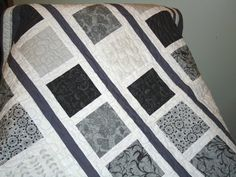 simple monochrome quilt | I like the mix of patterns in the material