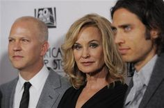 "Jessica Lange, center, a cast member in ""American Horror Story: Asylum,"" poses with co-creators Ryan Murphy, left, and Brad Falchuk at the premiere screening of the television series at Paramount Theatre on Saturday, Oct. 13, 2012, in Los Angeles. (Photo by Chris Pizzello/Invision/AP)"