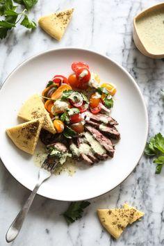 Herb Marinated Steak Gyros Plates with Tomato-Onion Salad and Green Tahini Sauce