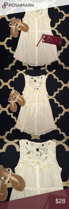 """🌼 Free People Boho Lace Glitter Gold Top M 🌸 Free People Boho Lace Glitter Gold Top M. This top has a drawstring middle to accent the waist. There is a beautiful intricate lace back and glittering gold accents throughout. The button down closure adds a flirty touch. This top is PERFECT for summer ☀️ Length: 32"""" Bust: 18"""" (pit to pit). Free People Tops Button Down Shirts"""