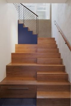 Back again to the idea of all that usable space under the stairs. You don't have to hide an entire room; drawers under the risers are a great idea. And you could just remove the noticeable handle you see at the bottom left.