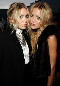 OLSENS ANONYMOUS MKA MARY KATE AND ASHLEY OLSEN FASHION STYLE BLOG FUR VEST DRESS LAYERED CHAIN NECKLACES COLLARED SHIRT JACKET BEAUTY CHANEL SHOW