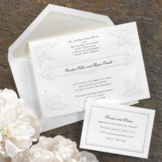 Embossed Pearlescent Floral Panel Invitation  This non-folding bright white panel invitation features an elegant embossed, pearlescent floral design. The invitation is designed to highlight your names in the center in the accent lettering style of your choice. Preview will break after first six lines. Our typesetters will adjust your wording accordingly to best fit this unique invitation.