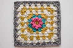 I love this granny square. I have a couple squares like this started but now I want them in these colors....