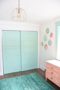 Decorating a baby girls nursery - This mint and pink room is all kinds of sweet with tons of DIY project ideas and budget-friendly decor items