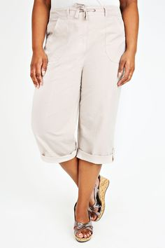Stone Cool Cotton Roll-Up Crop Trousers ($11.00)  Plus size stone cotton roll-up crop trousers with tab and button on the hem. Featuring a drawstring waist, belt loop holes and x4 open pockets. Made from 100% cool cotton for extra comfort.