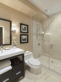 I like the tiled shower and the contrast between the white and dark vanity with matching mirror