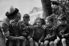 Evacuee children with nurse (England, 1940-1943)  (Children had to be evacuated from London to the countryside in order to protect them. The Nazis severely bombed London during The Battle of Britain; but the British fought hard for a long time and won!)
