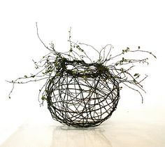 You could make this out of willow and then put it in your garden as a living sculpture!!