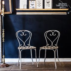 We love the basket weave seat and signature heart design on this pair of iron French garden chairs.