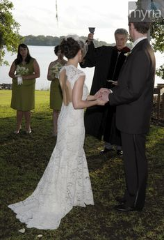 Open back of a gorgeous lace bridal gown for outdoor wedding