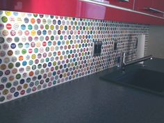 my friend supplied the bottlecaps for this backsplash--I think it is so cool! I totally wish I could do something like this but not sure it would go in our 1900s farmhouse :)