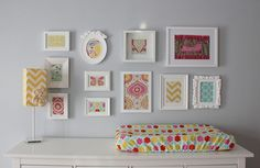 love the framed artwork - maybe fabric and scrapbook paper? + spray paint frames white