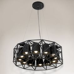 Multilamp Ring noire de Seletti par Emanuele Magini sur http://www.utileetfutile.fr/seletti/1850-suspension-multilamp-ring-noire-8008215014371.html