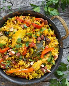 A quick weeknight paella dish ready in half an hour. This vegetarian paella is packed with plenty of healthy bits and savory highlights like olives and artichokes.