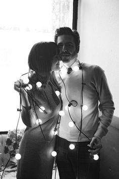 couple wrapped in Christmas lights... must try #abeautifulmess #blog