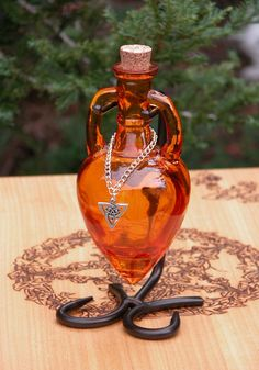 White Magick Alchemy - Ancient Magick Potion Bottle Vessel with Metal Stand - Amber, $23.95 (http://www.whitemagickalchemy.com/ancient-magick-potion-bottle-vessel-with-metal-stand-amber/)