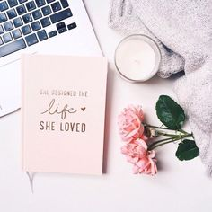 she designed a life she loved quote on book cover and flower flatlay