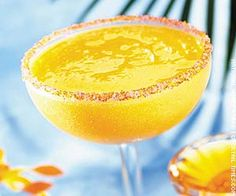 1 1/4 ounces of silver tequilla, 1 ounce triple sec, 1 1/2 ouces of freshly squeezed lemon juice, 2 ouces of sweet and sour mix, 3/4 cup partially frozen mango--Place all ingredients in a blender and blend until smooth. Pour the mixture into a sugar rimmed glass.