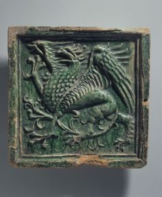 relief tile Square filler tile with the griffin pointing to the left, glazed green. Ceramic Pottery, Pottery Art, Ceramic Art, Church Of The Subgenius, Green Knight, Ceramic Boxes, Antique Tiles, Ceramic Techniques, Clay Tiles