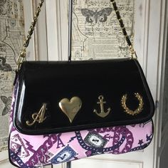 Shop Women's Fred Perry Purple Black size OS Satchels at a discounted price at Poshmark. Description: Fred Perry for Amy Winehouse Foundation charm print satchel purse. Stunning Fred Perry Amy Winehouse Multi-Coloured Satchel with Patent Faux Leather. Colours are of Black/Blue/Pink/Purple/White. Iconic metal badge of A for Amy, Heart for all the love she had, her anchor tattoo, and the Fred Perry logo. Satchel covered in chain links, her songbird, heats and Fred Perry ...
