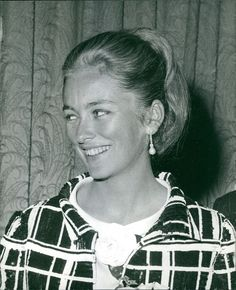 Vintage photo of Queen Paola of Belgium smiling.