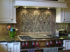 Mosaic Backsplash In Pattern Of Interlocking Ellipses In Mirrored Glass  With Complementary Fused Glass Tiles And
