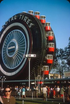 Uniroyal Ferris Wheel — New York World's Fair 1965   - photo from ElectroSpark, via Flickr (original 35mm Kodachrome transparency);  Designed by Shreve, Lamb & Harmon, the same architectural firm that designed the Empire State Building, the Uniroyal Giant Tire Ferris wheel carried over 2 million people.