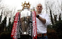 Ljungberg poses with the Barclays Premier League trophy
