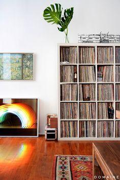Vinyl bookshelf and rainbow neon sign