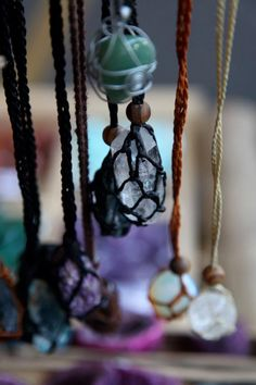 Crochet or macrame wrapped crystals and gems.