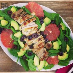 Grilled chicken salad - simple, perfect combo Organic chicken thighs were seasoned with sea salt, pepper & oregano. Salad consists of baby spinach, grapefruit, avocado and kalamata olives. Dressed...