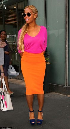 Brights! Beyonce Knowles stood-out in super hot neon pink and orange for the second day running, in NYC on Friday