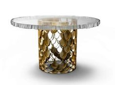 So modern top glass round dining table #BRABBU | See more at http://www.brabbu.com/en/casegoods/koi1-dining-table.php