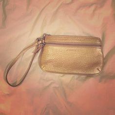 Gold Liz Claiborne wristlet Gold Liz Claiborne wristlet- barely used. Excellent condition! 2 zippered pockets. Bundle for more discounts!  Liz Claiborne Bags Clutches & Wristlets