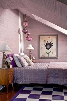 Dreamy Lavender Bedroom  A lavender master bedroom exudes a  dreamlike quality. Walls are covered in grass cloth from Philip Jeffries Ltd.,  while a checkerboard rug possesses richer jewel tones. Italian hanging lanterns  from Lee Jofa and an angled skylight give dimension to the limited space.