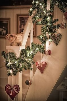 decorate stairs using fresh garland from Xmas, but add hearts for Valentines.