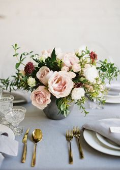 Swooning over this floral centerpiece that will look fabulous on the tables at the reception.