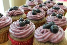 Blueberry Cupcakes topped with Blueberry Cream Cheese Frosting