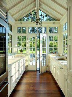 A smallish kitchen that seems much bigger because of the high ceiling and all those WINDOWS.