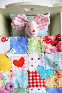 Patchwork quilt, crosses at joins,good idea