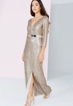 Channel Golden Goddess vibes in this stunning sequin embellished maxi dress from Little Mistress! Made to wow with a plunging neckline, fitted silhouette and front split, this dress is ideal for those glam evening parties and events where you want to make an unforgettable impression.  Plunging neckline Half length sleeves Sequin embellishment Front split Fitted design Gold tone belt included Rear zip fastening  Team LBD recommends: Keep accessories simple to let this look speak for ...