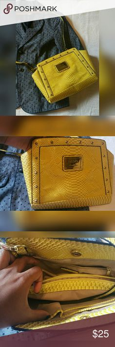Yellow Nicole Miller Handbag Purse --Bright yellow to add spice to your summer outfit --Add a pop of color to your fall pallette  --Gently loved purse, no stains  --Detachable strap to go from shoulder bag to clutch  Reasonable offers considered! Nicole by Nicole Miller Bags Crossbody Bags
