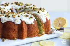 This Pistachio Lemon Bundt Cake is perfectly moist and full of flavor thanks to the addition of pistachio pudding. Topped with lemon icing and crushed pistachios, it's a great dessert for Easter, St. Patrick's Day or any Spring celebration. Pistachio Pudding, Pistachio Cake, Lemon Bundt Cake, Bundt Cakes, Pound Cake, Praline Cake, Imperial Sugar, Lemon Frosting, Great Desserts